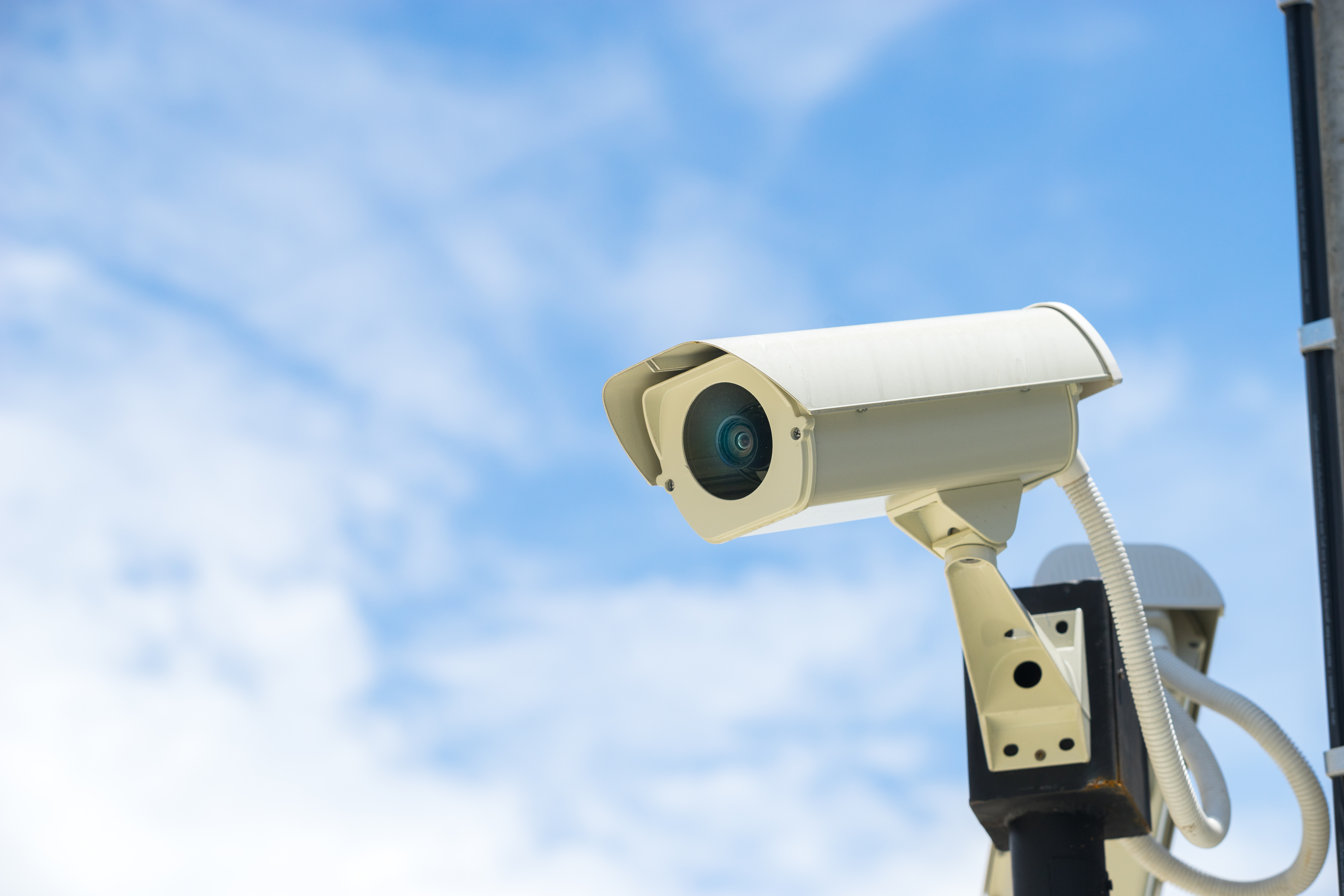an image of a basic cctv camera on a homestic home